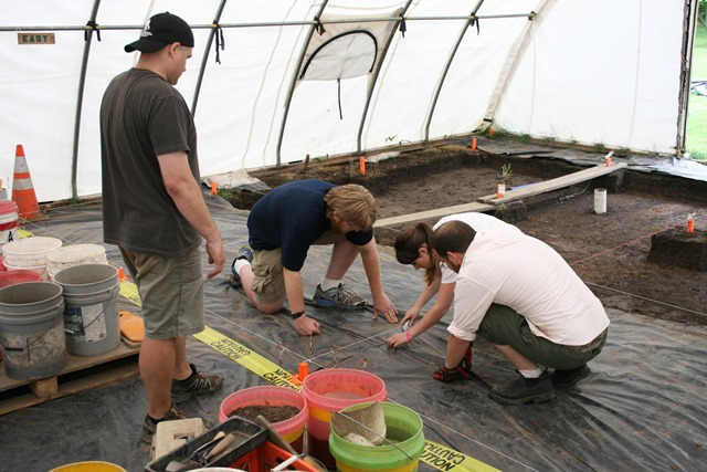 Cutting the tarp.