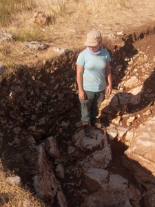 Kim Vyncke in a depression in the limestone bedrock, where iron ore was extracted