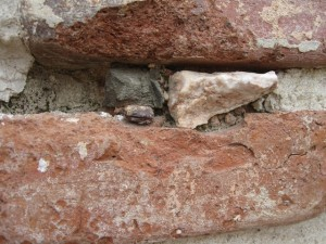 Figure 9: Clamp in situ wedged by stone at the Roman Baths