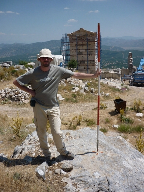 Figure 4 Simon Depas indicating the exact location of this geodetic point holding a range pole